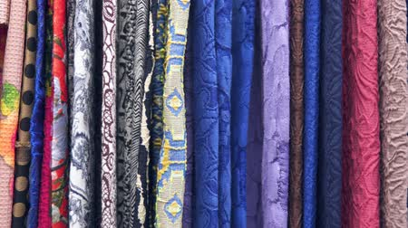 Drapery. Hundreds of different fabrics. Selection of various color options, camera movement along fabrics