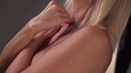 the girl covers her Breasts with hands Wideo