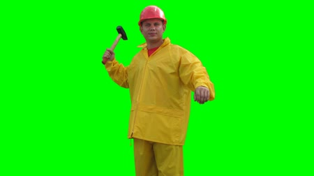 helmets : Builder spins with hammer on the Green Screen LOOP