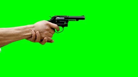 klucz : Male hands on green background shoot from gun