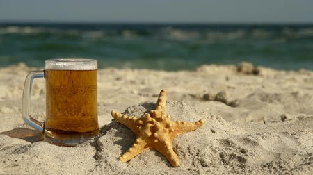 pint glass : Beer and Starfish on the beach Stock Footage