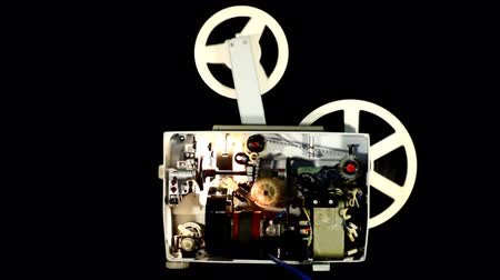 葡萄收获期 : Mechanism of the old projector on black background