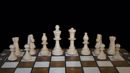 rytíř : Chess figures form on chess board and prepare to battle on black background