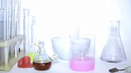chemistry : Mad professor conducts strange experiments with different chemical material. Stock Footage