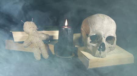 pirat : Human skull and voodoo doll in the smoke Wideo