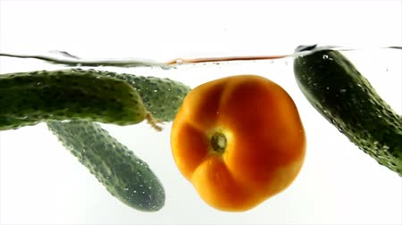 splashed : Splashing natural tomatoes and cucumber Stock Footage