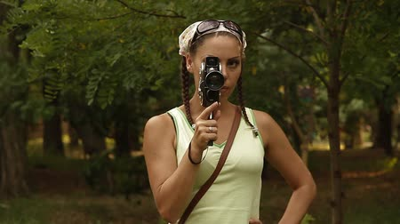 camera operator : Woman with old camera Stock Footage