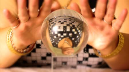 palmistry : fortuneteller moves on magic crystal ball hand