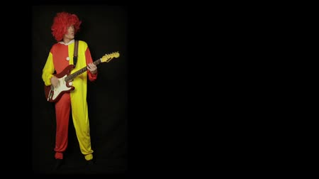rocks red : Clown with guitar