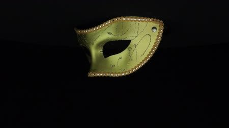 mask : Gold mask rotates on a black background loop