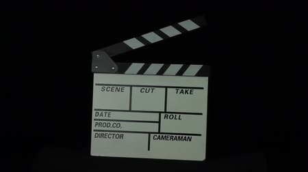 film slate : Movie clapper is rotated on a black background