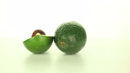 avokado : Avocado rotates on a white background