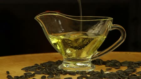 gourmet : Sunflower oil is poured into a glass gravy boat