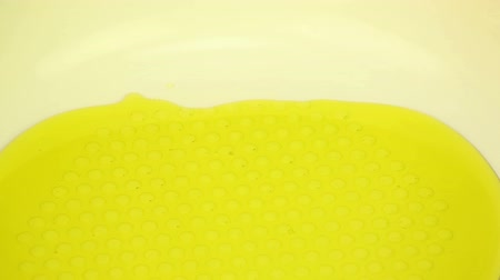 olive colored : Vegetable oil in a frying pan Stock Footage