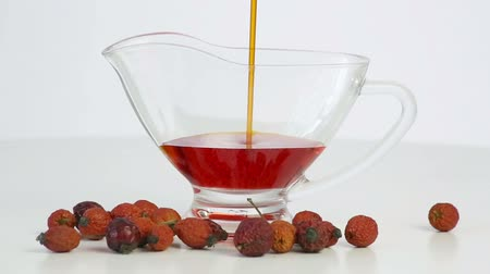 rosehips : Rosehip oil is poured into the cup
