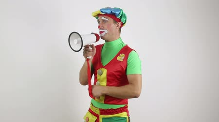 Clown with a megaphone on white background