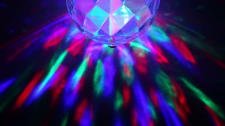 Lamp glows in colored light and rotates