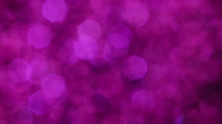 hó : Violet Merry Christmas magical bokeh lights background. Full HD video for the New Year backdrop.