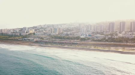 tyrkysový : Aerial view of coast in Haifa. Urban top view with azure ocean rippling waves 4K Dostupné videozáznamy