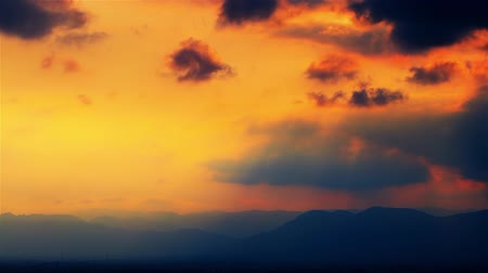 bolyhos : Orange, pink, violet and blue Sunset clouds fast moving over the sky. Dramatic Timelapse. FULL HD