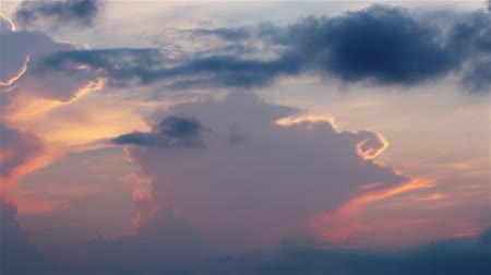 night scape : Orange, pink, violet and blue Sunset clouds fast moving over the sky. Dramatic Timelapse. FULL HD