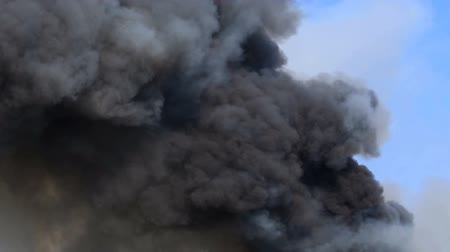 sky bomb : Billowing  black Smoke from burning