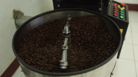 Mixing roasted coffee by modern machine in the factory