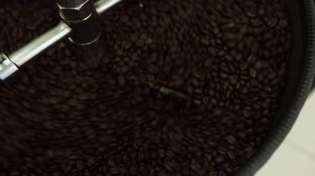 drinking coffee : Mixing roasted coffee by modern machine in the factory