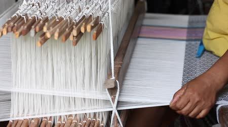 weave silk cotton on the manual wood loom, Thailand, selective focus,vintage color Wideo