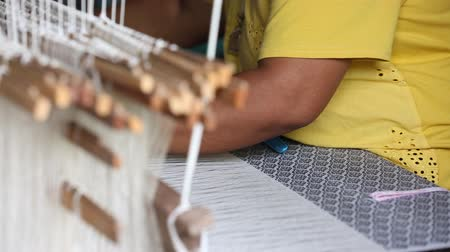 weave silk cotton on the manual wood loom, Thailand, selective focus, vintage color