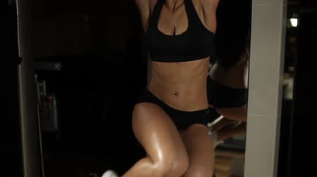 abs : Sporty Sexy Woman In Gym. Does exercise.