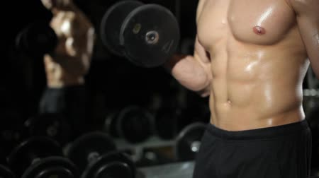 abs : Guy in the gym. Does exercises with dumbbells.