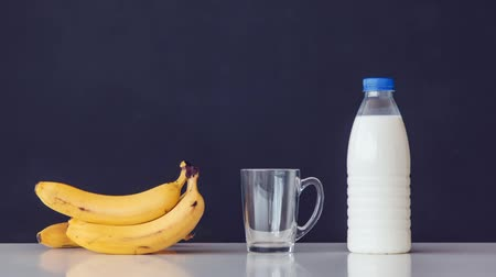 Milk with bananas. Breakfast. Stop motion animation and timelapse.