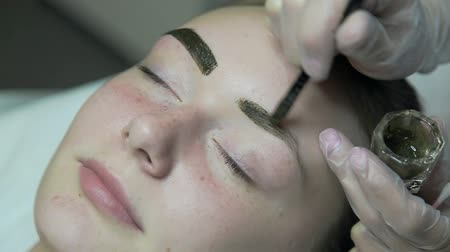 Painting eyebrows close-up Stock mozgókép