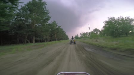 Boys ATV riding in the field. Stock mozgókép