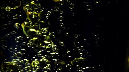 convex : Oil in water bubbles in motion on a background