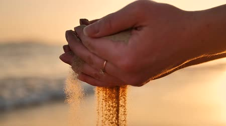 sifted : Sand running through a womans hands Stock Footage