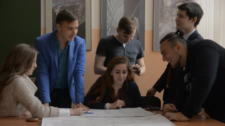 interactive table : Group of young businessmen discussing project. Successful students in the classroom. Cheerful people in the office Stock Footage