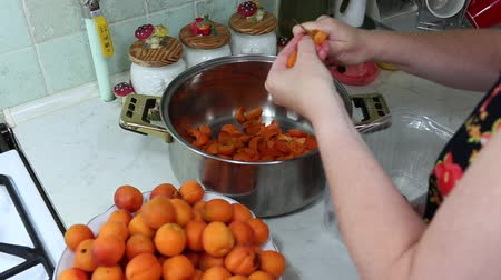 preparing : In the Polish kitchen. Preparing a delicious apricot jam.