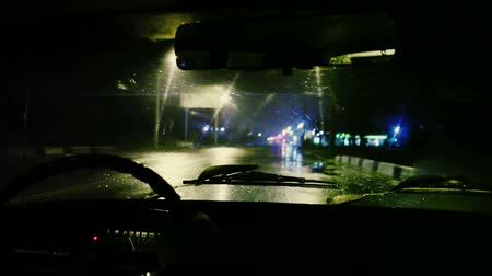 torpedo : The man sit into in the car, close up. Evening-night time in rainy weather, real time capture, inside view, control panel, wheel, wide angle Stock Footage