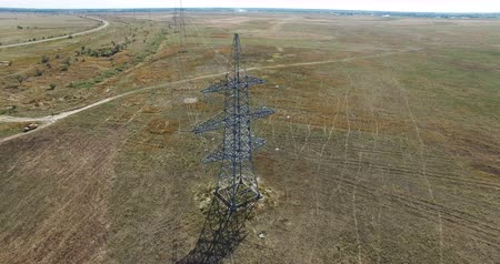 dizilirler : AERIAL: Flying up the high voltage electricity tower and power lines. Aerial drone shot. 4K 30fps