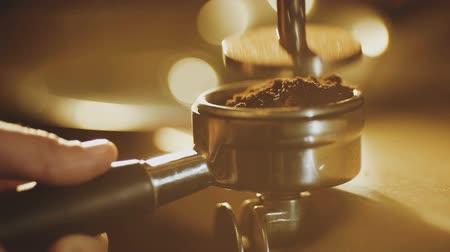 coffee grounds : Tamping fresh ground coffee