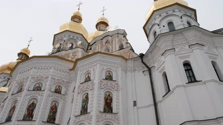 stoned : Church of the Nativity, Towers, Walls Are Brown Stoned by Half and White by Half, Images in a Semicircular Windows, Golden Cupolas , Crow is Flying, Holy Dormition Kiev-Pechersk Lavra Stock Footage