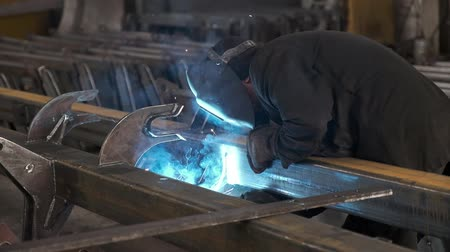 fire facilities : Welders working at the factory made metal. Slow motion