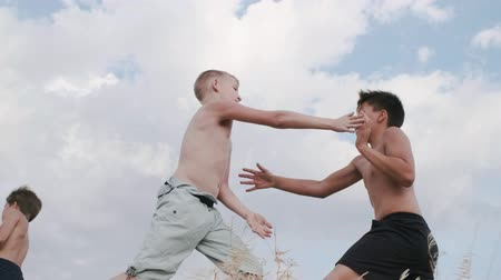 artes marciais : A view of two boys, figting on a training outdoors Martial Arts. Kickboxing. Stock Footage