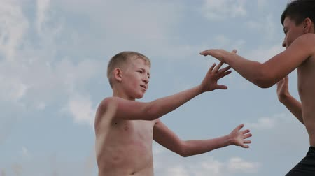 A view of two boys, figting on a training outdoors Stock mozgókép
