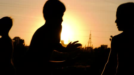 kavga : Silhouettes of young boys, jogging on a training against the sunset