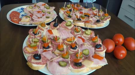 hors doeuvres : Sandwiches (canapes) of salami on a plate