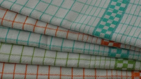 towel folded : Colorful dish towels on wooden table