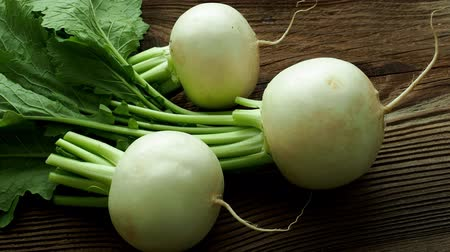 daikon radish : Daikon radish.Tasty fresh raw white round japanese radish with green stems and leaves